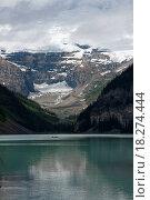 Купить «Lake Louise in Alberta Canada: a canoe glides over the glacier», фото № 18274444, снято 3 июля 2020 г. (c) easy Fotostock / Фотобанк Лори