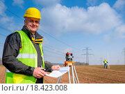 Купить «Geodesist wear reflective vest measure land», фото № 18423008, снято 16 июля 2019 г. (c) easy Fotostock / Фотобанк Лори