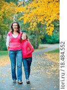 Купить «Cute girl with her mother walking in park», фото № 18484552, снято 19 сентября 2018 г. (c) easy Fotostock / Фотобанк Лори