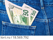 Купить «Banknotes of fifty U. S. dollars bill sticking out of the back jeans pocket», фото № 18569792, снято 17 августа 2018 г. (c) FotograFF / Фотобанк Лори