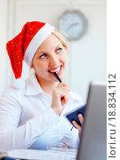 Купить «Santa helper working in office», фото № 18834112, снято 29 февраля 2020 г. (c) easy Fotostock / Фотобанк Лори