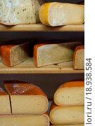 Купить «Cut cheese on shelves in store», фото № 18938584, снято 26 мая 2020 г. (c) easy Fotostock / Фотобанк Лори