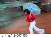 Купить «Girl running with umbrella», фото № 19067956, снято 15 ноября 2018 г. (c) easy Fotostock / Фотобанк Лори