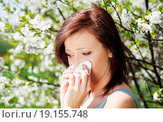 Купить «Girl with runny nose, having allergy among flowers.», фото № 19155748, снято 26 марта 2019 г. (c) easy Fotostock / Фотобанк Лори