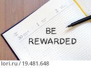 Купить «Be rewarded write on notebook», фото № 19481648, снято 23 февраля 2019 г. (c) PantherMedia / Фотобанк Лори