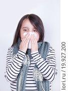 Купить «Девочка укутанная в шарф сморкается в белую салфетку», фото № 19927200, снято 3 июля 2015 г. (c) Emelinna / Фотобанк Лори