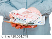 front view of many euro banknotes in cupped palms. Стоковое фото, фотограф Zoonar/Valery Voenny / easy Fotostock / Фотобанк Лори