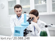 Купить «young scientists making test or research in lab», фото № 20088248, снято 4 декабря 2014 г. (c) Syda Productions / Фотобанк Лори