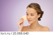 Купить «young woman cleaning face with exfoliating sponge», фото № 20088640, снято 31 октября 2015 г. (c) Syda Productions / Фотобанк Лори