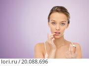 Купить «young woman applying lip balm to her lips», фото № 20088696, снято 31 октября 2015 г. (c) Syda Productions / Фотобанк Лори