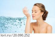 Купить «woman smelling perfume from wrist of her hand», фото № 20090252, снято 31 октября 2015 г. (c) Syda Productions / Фотобанк Лори