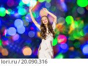Купить «happy young woman dancing over disco lights», фото № 20090316, снято 31 октября 2015 г. (c) Syda Productions / Фотобанк Лори