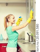 Купить «happy woman cleaning cabinet at home kitchen», фото № 20091580, снято 25 января 2015 г. (c) Syda Productions / Фотобанк Лори
