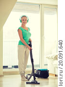 Купить «happy woman in headphones with vacuum cleaner», фото № 20091640, снято 25 января 2015 г. (c) Syda Productions / Фотобанк Лори