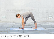 Купить «woman making yoga intense stretch pose on mat», фото № 20091808, снято 13 ноября 2015 г. (c) Syda Productions / Фотобанк Лори
