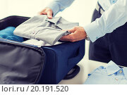 Купить «businessman packing clothes into travel bag», фото № 20191520, снято 13 ноября 2014 г. (c) Syda Productions / Фотобанк Лори