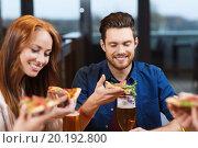 Купить «friends eating pizza with beer at restaurant», фото № 20192800, снято 8 ноября 2015 г. (c) Syda Productions / Фотобанк Лори