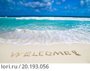 Купить «welcome written in a sandy tropical beach», фото № 20193056, снято 22 февраля 2013 г. (c) easy Fotostock / Фотобанк Лори