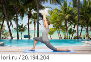 Купить «happy woman making yoga in low lunge over beach», фото № 20194204, снято 13 ноября 2015 г. (c) Syda Productions / Фотобанк Лори