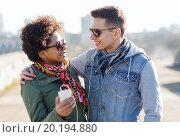Купить «smiling couple with smartphone and earphones», фото № 20194880, снято 19 марта 2015 г. (c) Syda Productions / Фотобанк Лори