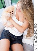 Купить «young woman playing with her tinny dog at home», фото № 20202980, снято 12 августа 2012 г. (c) easy Fotostock / Фотобанк Лори