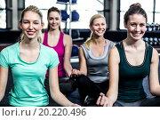 Купить «Fit group doing yoga», фото № 20220496, снято 18 июля 2015 г. (c) Wavebreak Media / Фотобанк Лори