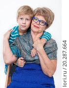 Купить «Внук обнимает довольную бабушку, белый фон», фото № 20287664, снято 13 декабря 2015 г. (c) Кекяляйнен Андрей / Фотобанк Лори