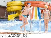 Купить «brother and sister standing by the pool with water slides», фото № 20391936, снято 4 августа 2014 г. (c) Losevsky Pavel / Фотобанк Лори