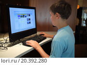 Купить «Little boy is surfing internet alone in the room.», фото № 20392280, снято 5 сентября 2014 г. (c) Losevsky Pavel / Фотобанк Лори