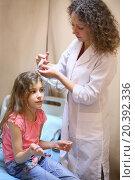 Купить «Medical worker will put electrode gel on the girls head for electroencephalography», фото № 20392336, снято 19 июня 2014 г. (c) Losevsky Pavel / Фотобанк Лори