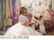 Купить «RUSSIA, MOSCOW - 18 DEC, 2014: Little girl (with model release) in evening dress is sitting next to the dog at Aquamarine circus.», фото № 20392696, снято 18 декабря 2014 г. (c) Losevsky Pavel / Фотобанк Лори