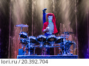 Купить «RUSSIA, MOSCOW - 18 DEC, 2014: Performer is playing on the drum kit on stage at Aquamarine circus.», фото № 20392704, снято 18 декабря 2014 г. (c) Losevsky Pavel / Фотобанк Лори