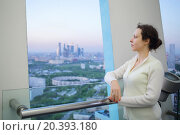 Купить «young girl standing on top floor of tall building and watching from the balcony», фото № 20393180, снято 9 мая 2014 г. (c) Losevsky Pavel / Фотобанк Лори