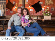 Купить «man and woman sitting on a bench in saloon», фото № 20393380, снято 29 июня 2014 г. (c) Losevsky Pavel / Фотобанк Лори