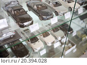 Купить «MOSCOW - MAY 14, 2014: Model line Mersedets Benz cars in miniature in dealership Mercedes-Benz Avilon in Moscow», фото № 20394028, снято 14 мая 2014 г. (c) Losevsky Pavel / Фотобанк Лори