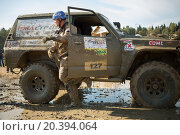 Купить «RUSSIA, PUSHKINO – 20 SEP, 2014: Driver is going out from off-road vehicle at Rainforest Challenge Russia Autumn 2014 PRO-X.», фото № 20394064, снято 20 сентября 2014 г. (c) Losevsky Pavel / Фотобанк Лори