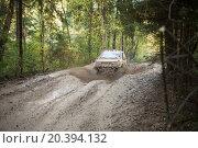 Купить «RUSSIA, PUSHKINO – 20 SEP, 2014: Off--road vehicle is driving on the wood at Rainforest Challenge Russia Autumn 2014 PRO-X.», фото № 20394132, снято 20 сентября 2014 г. (c) Losevsky Pavel / Фотобанк Лори