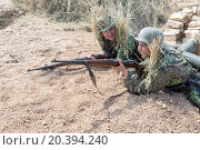 Купить «NELIDOVO, RUSSIA- JULY 12, 2014: Battlefield 2014: two Nazi soldiers laugh with rifles in trench», фото № 20394240, снято 12 июля 2014 г. (c) Losevsky Pavel / Фотобанк Лори