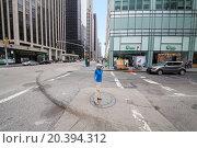 Купить «USA, NEW-YORK - AUG 23, 2014: Boy (with model release) is standing on the street and shooting.», фото № 20394312, снято 23 августа 2014 г. (c) Losevsky Pavel / Фотобанк Лори