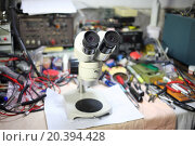 Купить «Magnifying devices to work with the chips on a master workplace», фото № 20394428, снято 23 мая 2014 г. (c) Losevsky Pavel / Фотобанк Лори