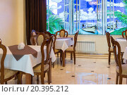 Купить «ADLER, RUSSIA - JULY 23, 2014: interior of the restaurant with a large stained-glass window», фото № 20395212, снято 23 июля 2014 г. (c) Losevsky Pavel / Фотобанк Лори