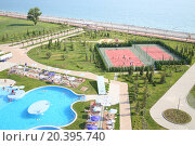 Купить «SOCHI, RUSSIA - JUL 26, 2014: Territory of the Hotel Radisson Blu Paradise Resort and Spa with swimming pool, playground and beach», фото № 20395740, снято 26 июля 2014 г. (c) Losevsky Pavel / Фотобанк Лори