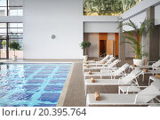 Купить «SOCHI, RUSSIA - JUL 27, 2014: Interior space with an indoor pool and loungers in the Hotel Radisson Blu Paradise Resort and Spa», фото № 20395764, снято 27 июля 2014 г. (c) Losevsky Pavel / Фотобанк Лори