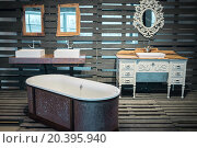 Купить «RUSSIA, MOSCOW – 07 DEC, 2014: Vintage beautiful bath and sinks in wooden pavilion at Artplay center of design.», фото № 20395940, снято 7 декабря 2014 г. (c) Losevsky Pavel / Фотобанк Лори