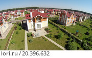 Купить «Aerial view many similar houses in gated development at sunny summer day.», фото № 20396632, снято 5 июня 2014 г. (c) Losevsky Pavel / Фотобанк Лори