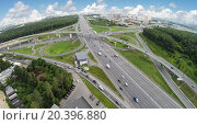 Купить «Transport traffic on Novorizhskaja flyover and Moscow ring road at summer day. Aerial view. Photo with noise from action camera.», фото № 20396880, снято 5 июля 2014 г. (c) Losevsky Pavel / Фотобанк Лори