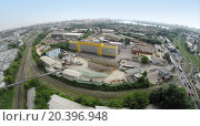 Купить «RUSSIA, MOSCOW – JUN 7, 2014: Aerial view of cityscape and cement - concrete factory, Mechanization-2. Photo with noise from action camera», фото № 20396948, снято 7 июня 2014 г. (c) Losevsky Pavel / Фотобанк Лори