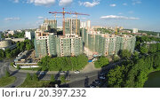 Купить «RUSSIA, MOSCOW - MAY 23, 2014: Car traffic near building site of dwelling complex Vinogradny at spring sunny day. Aerial view», фото № 20397232, снято 23 мая 2014 г. (c) Losevsky Pavel / Фотобанк Лори