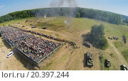 Купить «RUSSIA, NELIDOVO – JUL 12, 2014: People watch fight of Soviet and German armies during reconstruction Battlefield at summer day. Aerial view. (Photo with noise from action camera)», фото № 20397244, снято 12 июля 2014 г. (c) Losevsky Pavel / Фотобанк Лори