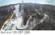 Купить «MOSCOW, RUSSIA - MAR 08, 2014: Cableway on snow-covered slope among trees during Speed Descend on Skates competition by Red Bull at sunny day. Aerial view», фото № 20397288, снято 8 марта 2014 г. (c) Losevsky Pavel / Фотобанк Лори